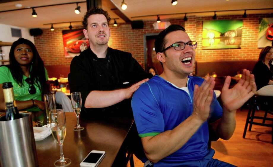 Bar Rosso chef Massimo Stecchi, left, and manager Andrea Lombardi, right, watch watch the Italy vs. England World Cup game at the Stamford, Conn., restaurant on Saturday, June 14, 2014. Photo: Lindsay Perry / Stamford Advocate