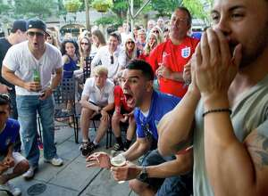 Soccer fans watch the Italy vs. England World Cup game at Tigin in Stamford, Conn., on Saturday, June 14, 2014.