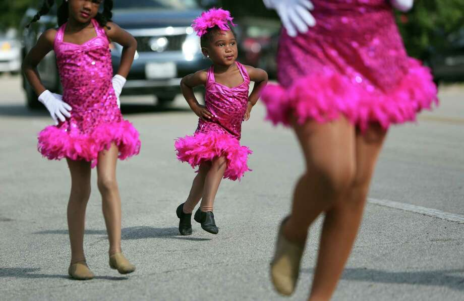 Casidee Davis, 3, joins the Design To Dance team who performs during the Emancipation Park's Juneteenth Parade on Saturday in Houston. Photo: Mayra Beltran, Houston Chronicle / © 2014 Houston Chronicle