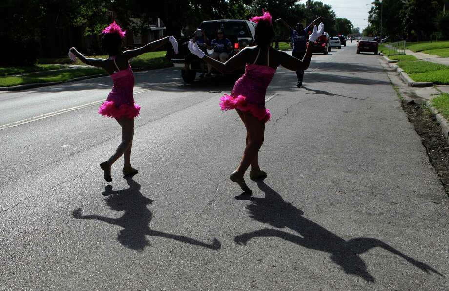 The Design To Dance group perform during the Emancipation Park's Juneteenth Parade on Saturday in Houston. Photo: Mayra Beltran, Houston Chronicle / © 2014 Houston Chronicle