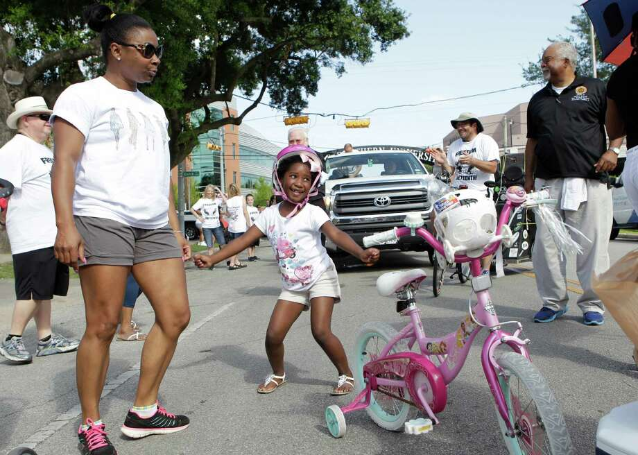 Parade participants start dancing as the Emancipation Park's Juneteenth Parade gets underway along Wheeler St. on Saturday in Houston. Photo: Mayra Beltran, Houston Chronicle / © 2014 Houston Chronicle
