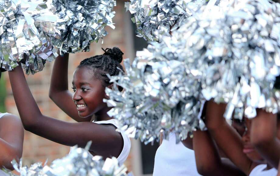 Kaitlynn Davis, 11, joins the Diamond Divas who participate in the Emancipation Park's Juneteenth Parade on Saturday in Houston. Photo: Mayra Beltran, Houston Chronicle / © 2014 Houston Chronicle