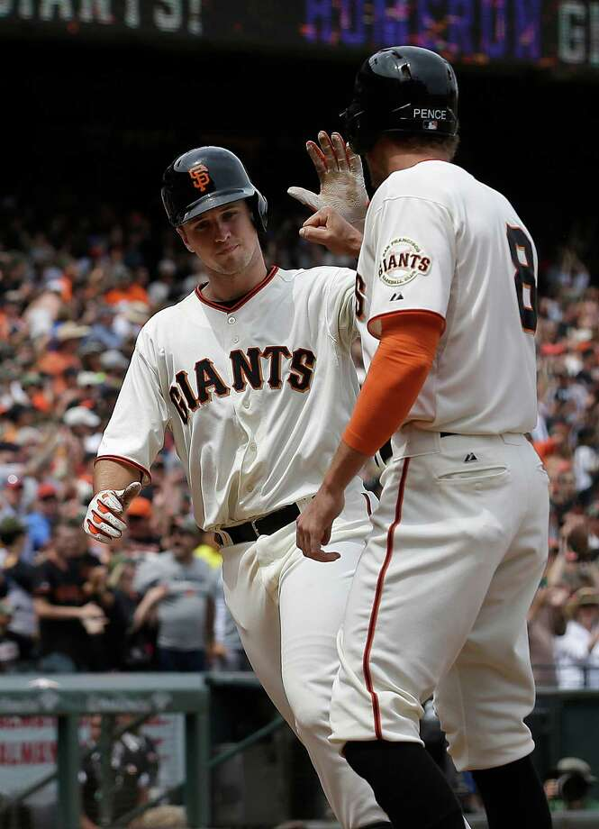 Buster Posey (left) and Hunter Pence bring significant postseason experience into the wild-card game. Unlike Pence, Posey also brings a hot bat, having hit .393 in September. Photo: Jeff Chiu / Associated Press / AP