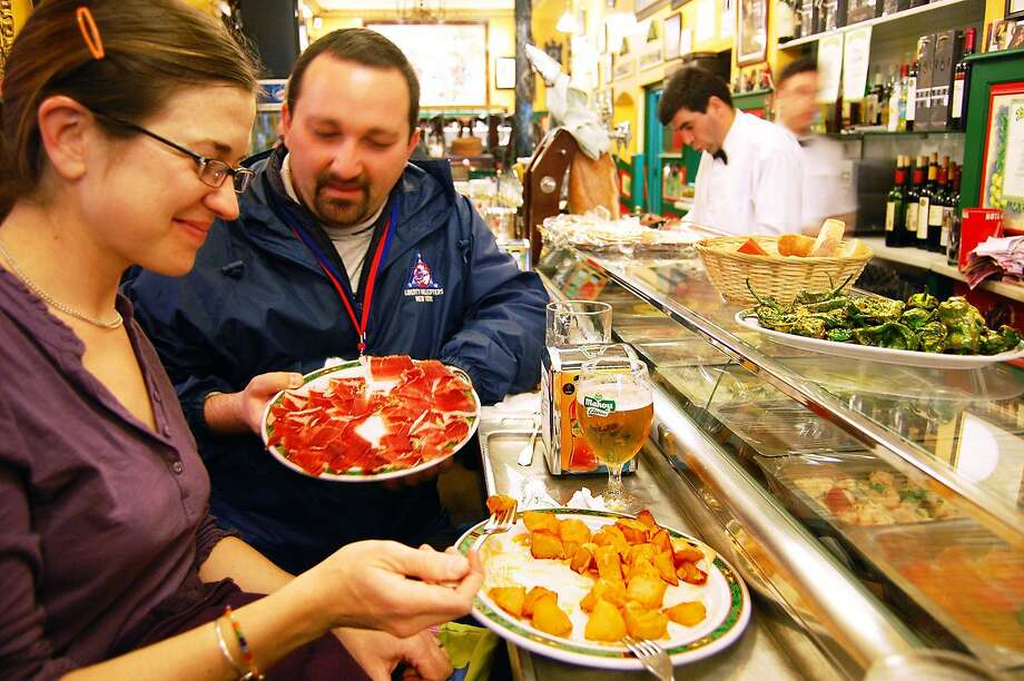 Making a meal of the tasty tapas available in bars throughout the day is a good solution for travelers who can't wait until 9 or 10 p.m., when dinner, a light meal, is served in Spain. Photo: Rick Steves