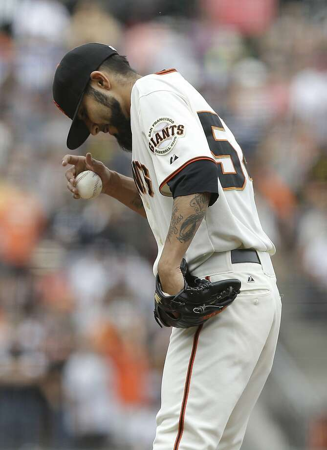 San Francisco Giants pitcher Sergio Romo (54) stands on the mound after allowing a two-run inside-the-park home run to Colorado Rockies' Brandon Barnes during the ninth inning of a baseball game in San Francisco, Saturday, June 14, 2014. The Rockies won 5-4. (AP Photo/Jeff Chiu) Photo: Jeff Chiu, Associated Press