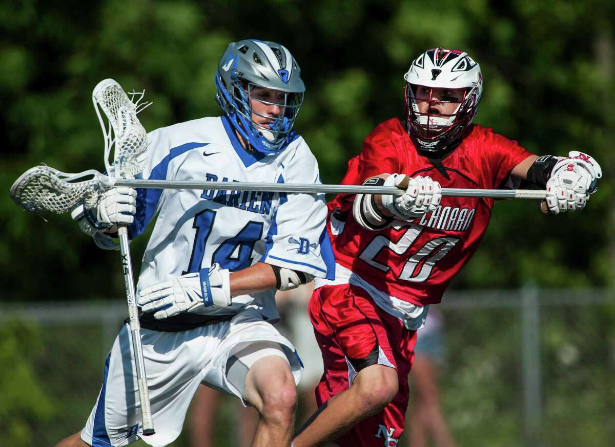 Darien high school's Kyle Cornell tries to get by New Canaan high school's Grayson Kristoff during the CIAC class M boys lacrosse championship game played at Brien McMahon high school, Norwalk,CT on Saturday, June 14th, 2014.