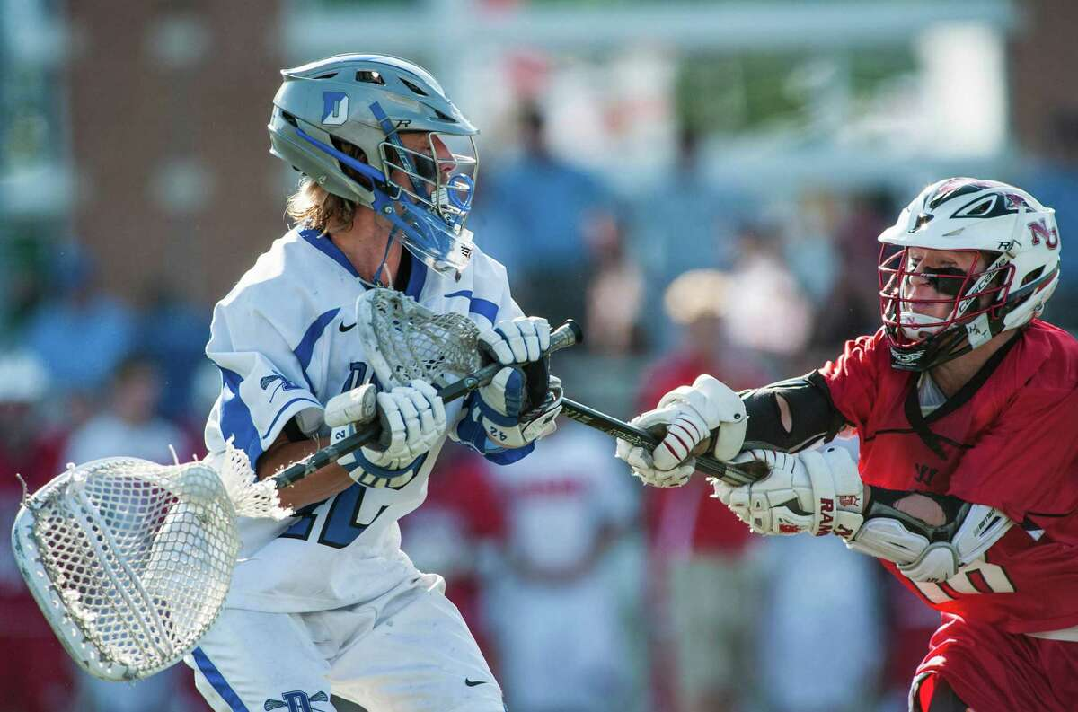 Darien high school goalie Paul Huffard tries to clear the ball during the CIAC class M boys lacrosse championship game against New Canaan high school played at Brien McMahon high school, Norwalk,CT on Saturday, June 14th, 2014.