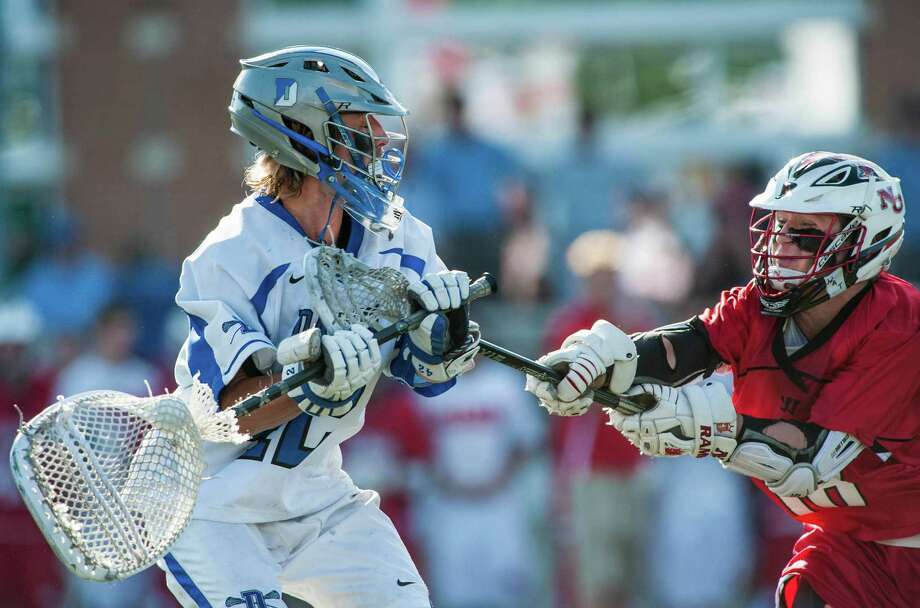 Darien high school goalie Paul Huffard tries to clear the ball during the CIAC class M boys lacrosse championship game against New Canaan high school played at Brien McMahon high school, Norwalk,CT on Saturday, June 14th, 2014. Photo: Mark Conrad / Connecticut Post Freelance