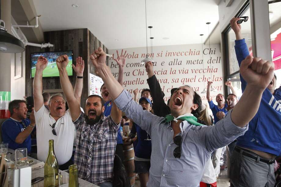Italy fans Emanuele Gastel, 25, right, cheers with Savino Cancellara, 30, center, and Vince Lamanna, far left, after Italy scored the first goal during the England vs. Italy World Cup match June 14, 2014 at Il Casaro in San Francisco, Calif. Photo: Leah Millis, The Chronicle