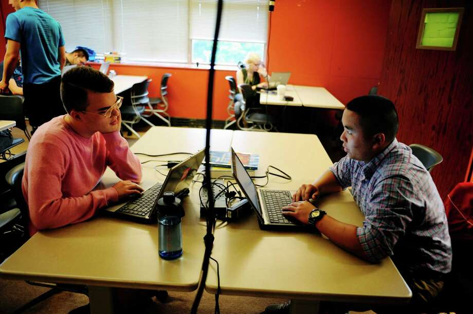 Seniors, Troy O'Neill, left, 17, and Cullen Utermark, 17, work on their computers at Tech Valley High School on Wednesday, June 11, 2014, in Rensselaer, N.Y.   (Paul Buckowski / Times Union) Photo: Paul Buckowski / 00027310A
