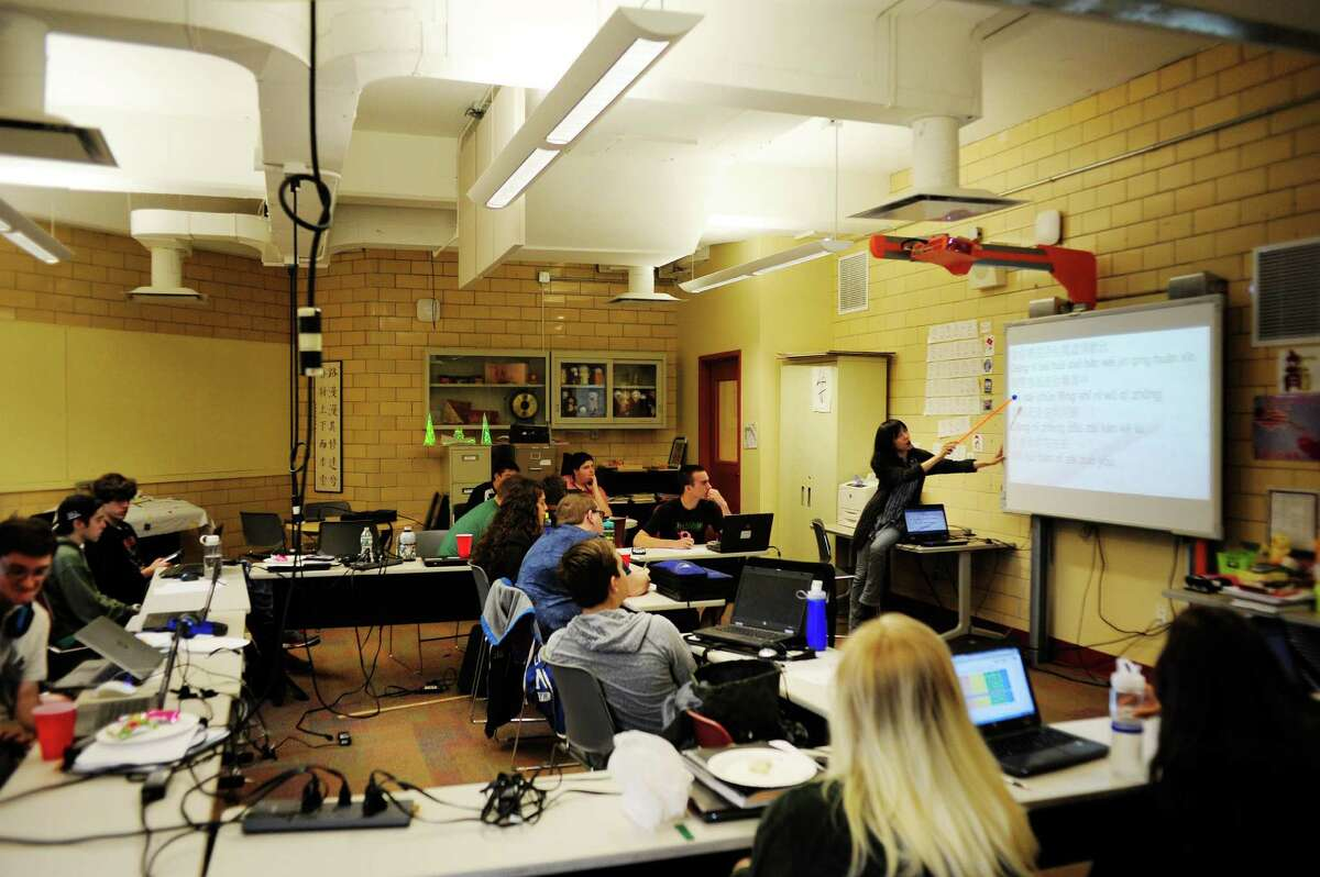 Language teacher, Sophia Hsia, background right, teaches students a Chinese song at Tech Valley High School on Wednesday, June 11, 2014, in Rensselaer, N.Y. (Paul Buckowski / Times Union)