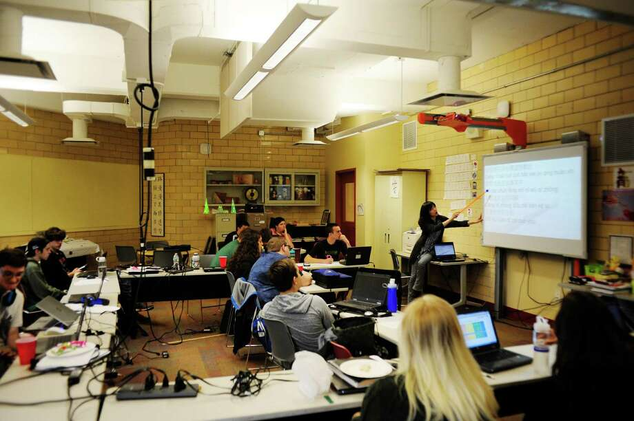 Language teacher, Sophia Hsia, background right, teaches students a Chinese song at Tech Valley High School on Wednesday, June 11, 2014, in Rensselaer, N.Y.   (Paul Buckowski / Times Union) Photo: Paul Buckowski / 00027310A