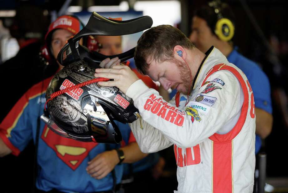 Driver Dale Earnhardt Jr., prepares for his qualifying session for the NASCAR Sprint Cup series auto race at Michigan International Speedway in Brooklyn, Mich., Saturday, June 14, 2014. (AP Photo/Carlos Osorio) ORG XMIT: MICO106 Photo: Carlos Osorio / AP