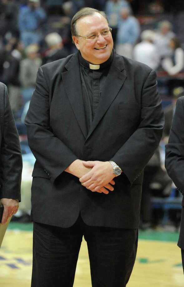Siena College President Fr. Kevin Mullen during a basketball game against Navy at the Times Union Center in Albany, N.Y. Wednesday, Nov. 16, 2011.  (Lori Van Buren / Times Union) Photo: Lori Van Buren / 00015373A