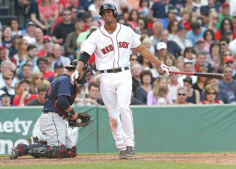 BOSTON, MA - JUNE 14:  Xander Bogaerts #2 of the Boston Red Sox reacts after he struck out with a man in scoring position against the Cleveland Indians in the fifth inning  at Fenway Park on June 14, 2014 in Boston, Massachusetts.  (Photo by Jim Rogash/Getty Images) ORG XMIT: 477584933 Photo: Jim Rogash / 2014 Getty Images