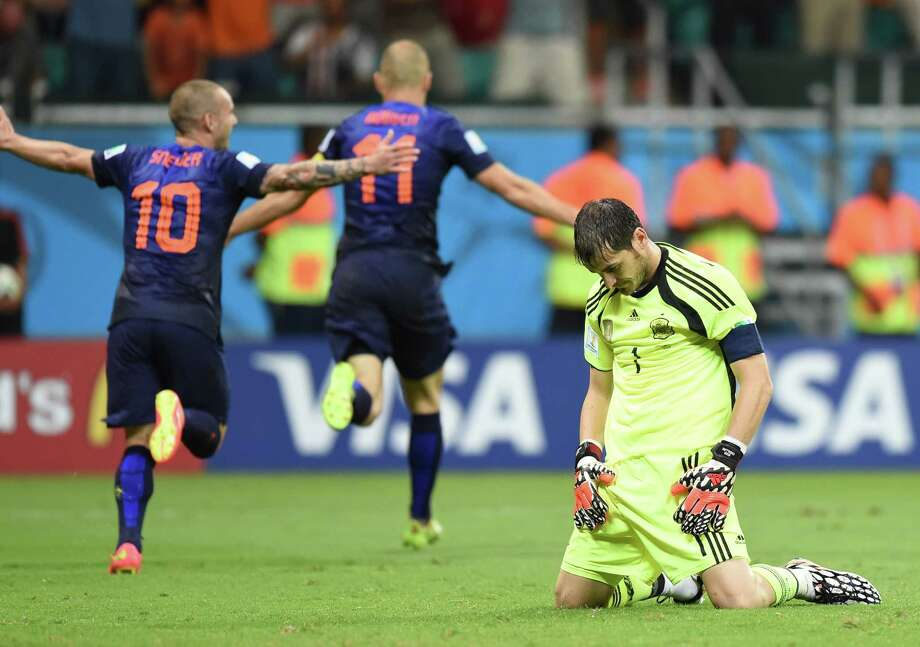 Keeper Iker Casillas was hanging his head after the Netherlands torched Spain 5-1 on Friday, but the Spanish say they won't throw in the towel in Brazil. Photo: JAVIER SORIANO, Staff / AFP