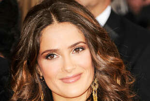 Ombré highlights give Salma Hayek's own curls extra bounce.    Read more:  Haircuts that take off 10 years