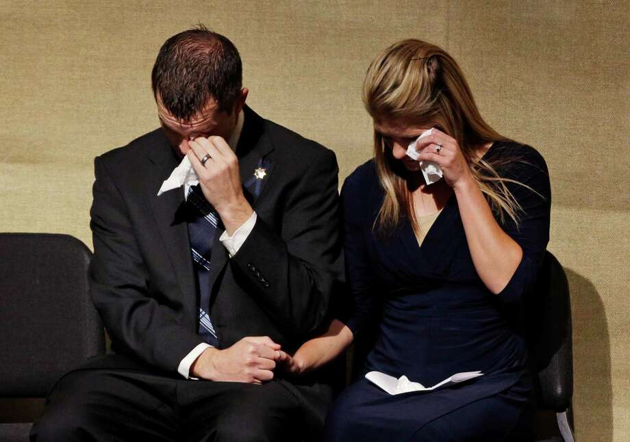Joseph Beck and Elizabeth Krmpotich mourn their brother, Las Vegas police officer Alyn Beck. Photo: John Locher, POOL / Pool, John Locher
