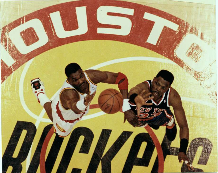 Rockets legend Hakeem Olajuwon, left, and Knicks great Patrick Ewing had several memorable meetings during their careers, including a battle in the 1994 NBA Finals. Photo: Houston Chronicle File / Houston Post files