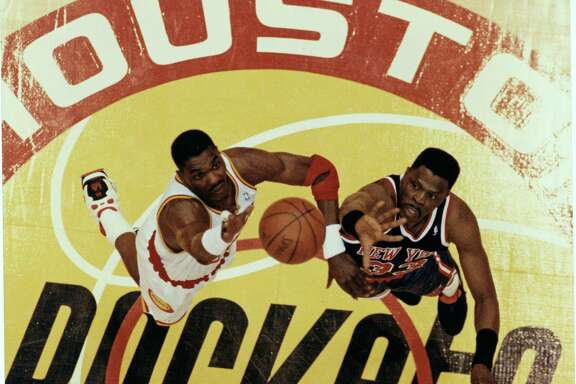 Rockets legend Hakeem Olajuwon, left, and Knicks great Patrick Ewing had several memorable meetings during their careers, including a battle in the 1994 NBA Finals.