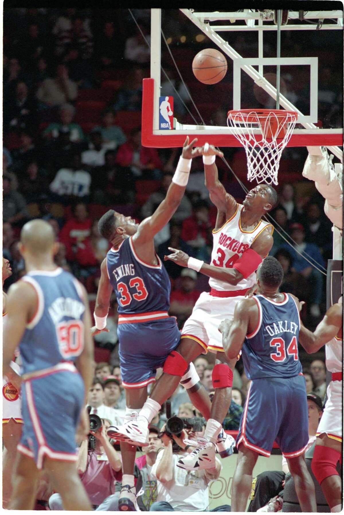 Former Knicks center Patrick Ewing (33) often got an up-close view of Hakeem Olajuwon's greatness during their Hall of Fame careers.