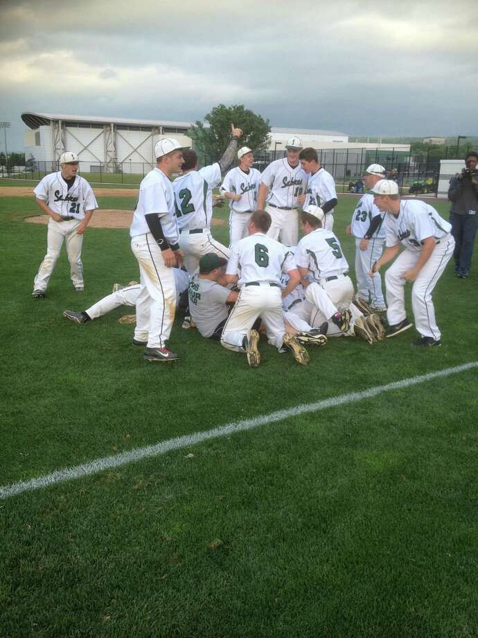 The Schalmont baseball team celebrates its state championship Saturday after a 3-1 victory over Rye Neck in the title game in Vestal. (Tom Robinson / Special to the Times Union)