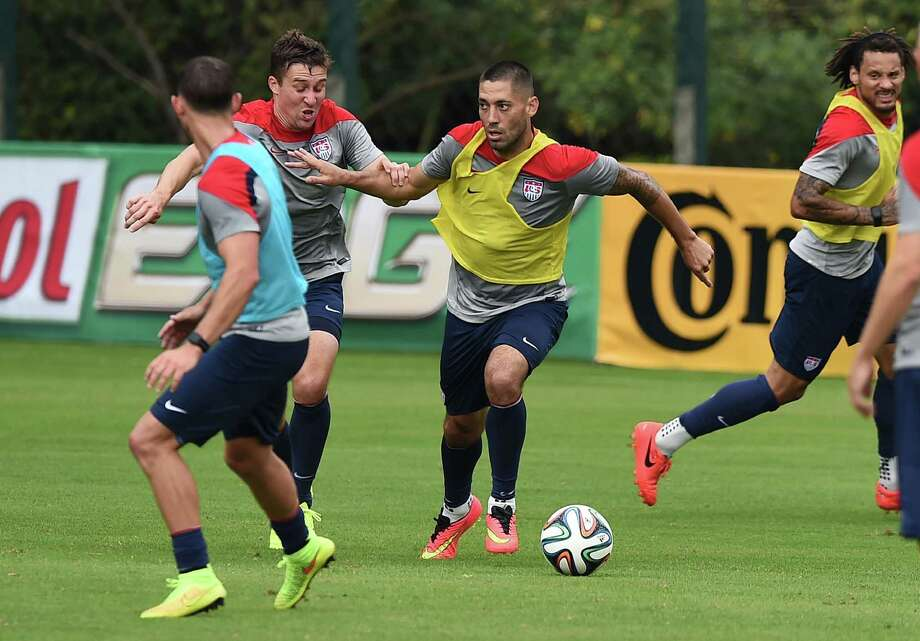 Captain Clint Dempsey, center, of Nacogdoches, leads the U.S. team into its first match of the 2014 World Cup against Ghana on Monday. Photo: JEWEL SAMAD, Staff / AFP
