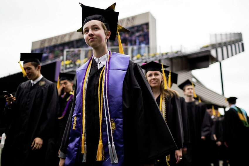 Thousands of graduates take to the field for the University of Washington's 139th Commencement Ceremony Saturday, June 14, 2014, in Seattle, Wash. Over 12,400 degrees were conferred. For the past two years, UW held the commencement at CenturyLink Field while Husky Stadium was being renovated.