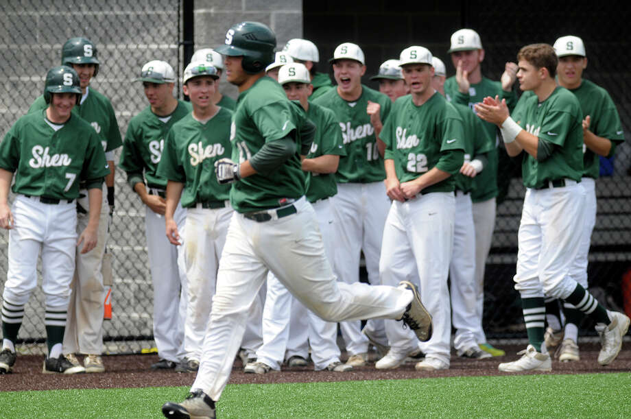Shenendehowa Plainsmen varsity shortstop Justin Yurchak #21, center, runs home from third off of a base hit during the top of the 4th inning during the NYSPHSAA AA semi-finals on Saturday, June 14, 2014 ,at Gary Crooks Field in Endwell, N.Y. (Tom Brenner/ special to the Times Union) Photo: Tom Brenner