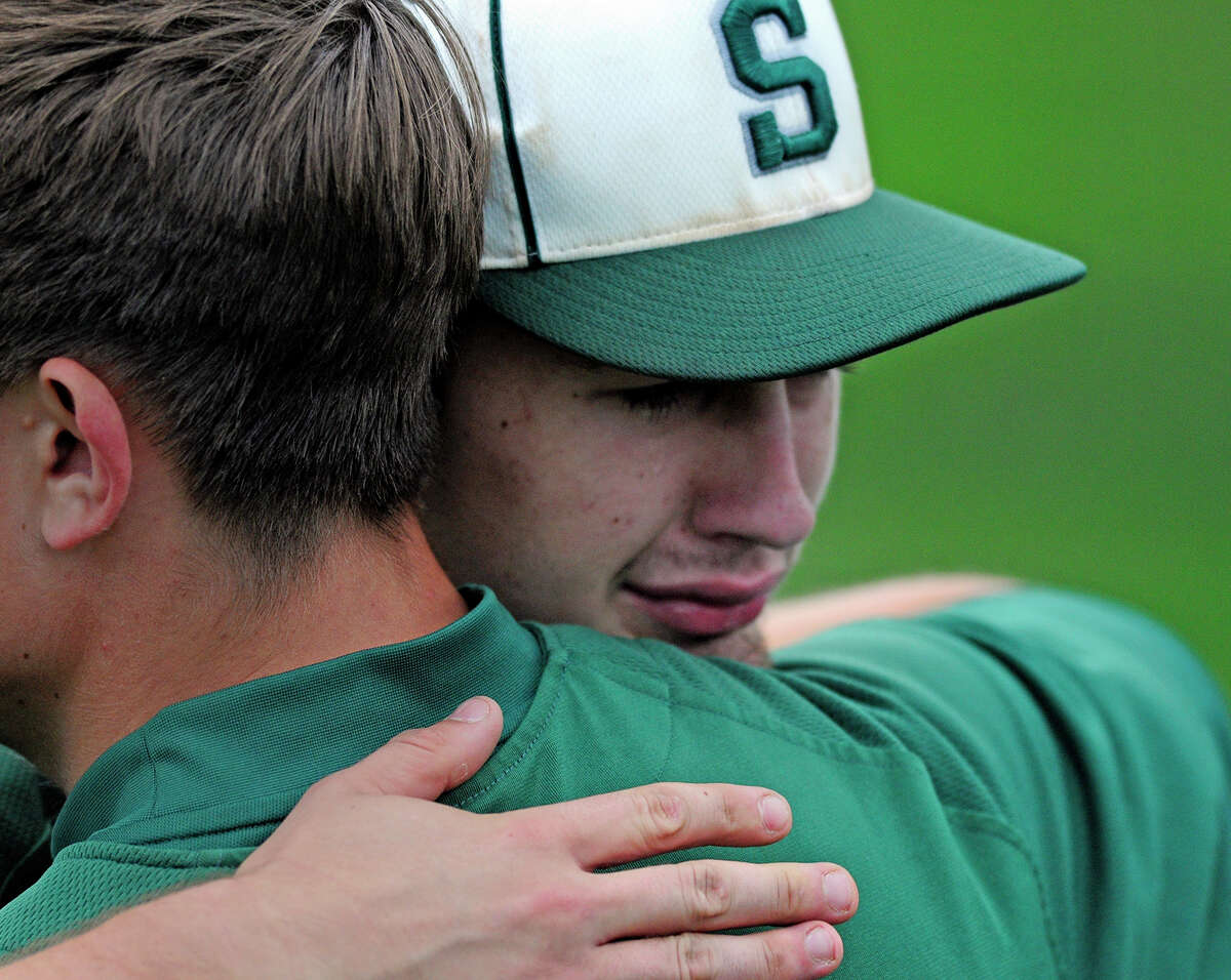 Shenendehowa Plainsmen's John Novenche, right, takes a moment to hug a fellow teammate after loosing to Victor Blue Devils 3-0 at the NYSPHSAA AA championship game versus Victor Blue Devils on Saturday, June 14, 2014 at Gary Crooks Field in Endwell, N.Y. (Tom Brenner/ special to the Times Union)