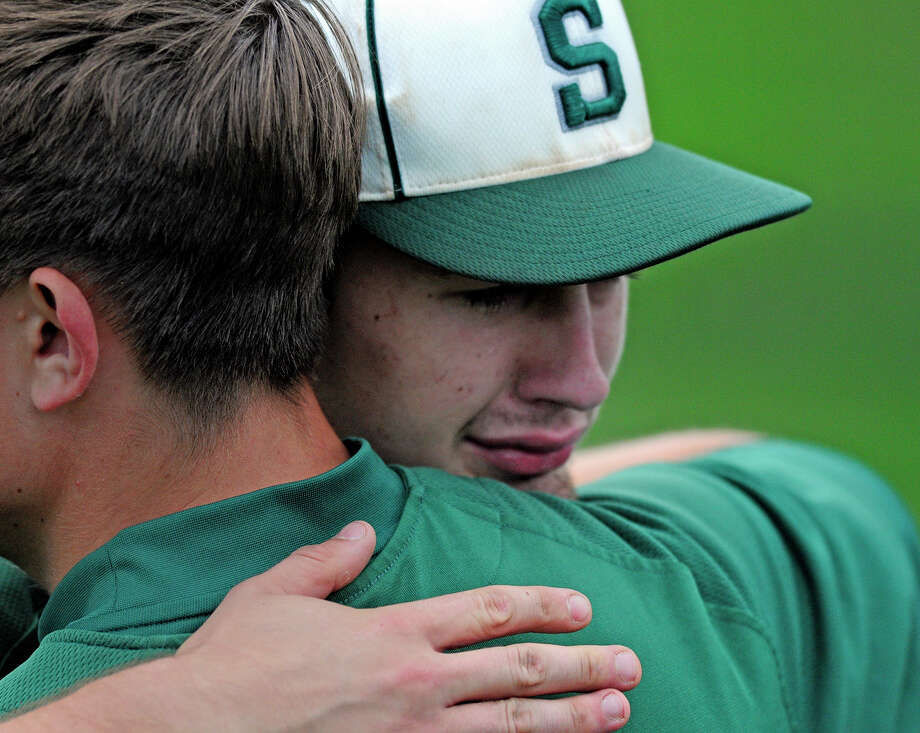 Shenendehowa Plainsmen's John Novenche, right, takes a moment to hug a fellow teammate after loosing to Victor Blue Devils 3-0 at the NYSPHSAA AA championship game versus Victor Blue Devils on Saturday, June 14, 2014 at Gary Crooks Field in Endwell, N.Y. (Tom Brenner/ special to the Times Union) Photo: Tom Brenner / ©Tom Brenner/ Albany Times Union