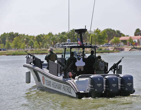 A Texas Department of Public Safety marine unit patrols the Rio Grande southwest of McAllen. / ©2014 San Antonio Express-News