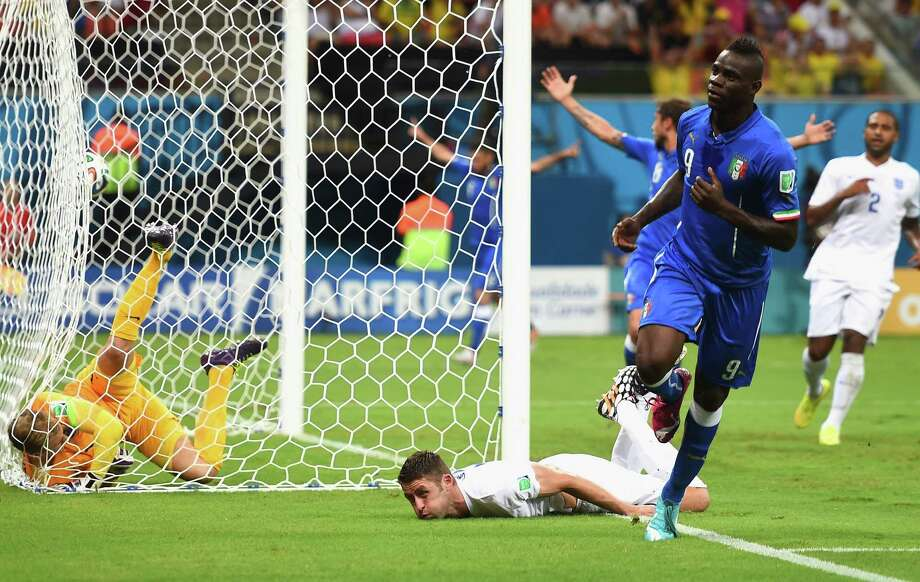 MANAUS, BRAZIL - JUNE 14:  Mario Balotelli of Italy celebrates after scoring the second goal during the 2014 FIFA World Cup Brazil Group D match between England and Italy at Arena Amazonia on June 14, 2014 in Manaus, Brazil.  (Photo by Christopher Lee/Getty Images) ORG XMIT: 491676919 Photo: Christopher Lee / 2014 Getty Images