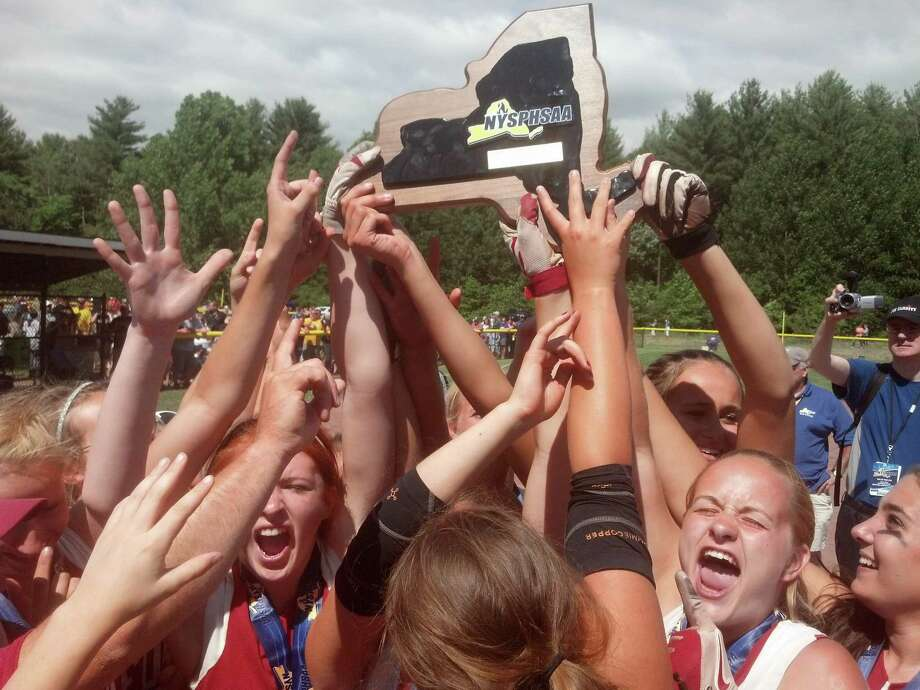 The Fort Ann softball team celebrates its Class D state championship Saturday. (Pete Dougherty / Times Union)