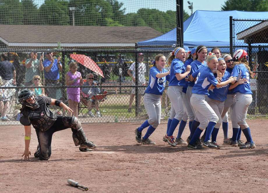 Troy catcher #3, Victoria Hallet, left, is slow to get up as Wiliamsville South players celebrate their win in the Class A state semifinal game Saturday June 14, 2014, in South Glens Falls, NY. (John Carl D'Annibale / Times Union) Photo: John Carl D'Annibale / 00027328A