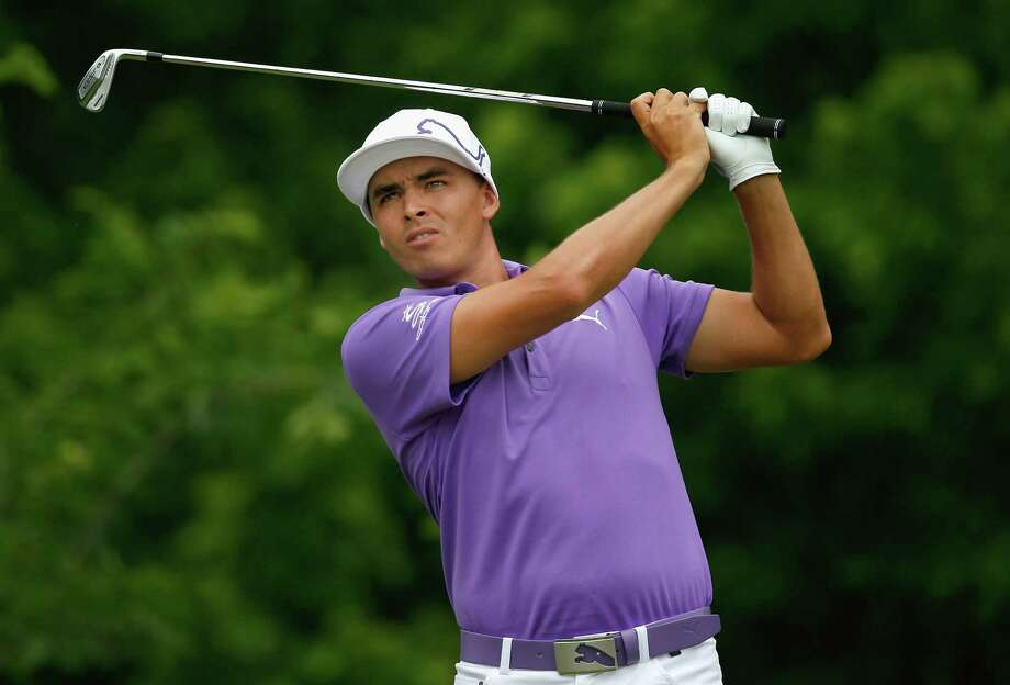 FORT WORTH, TX - MAY 23: Rickie Fowler tees off on the eighth hole during Round Two of the Crowne Plaza Invitational at Colonial on May 23, 2014 at Colonial Country Club in Fort Worth, Texas.  (Photo by Tom Pennington/Getty Images) Photo: Tom Pennington, Staff / 2014 Getty Images