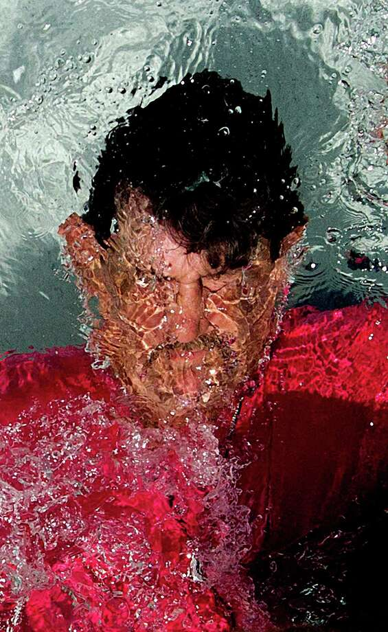 """""""I am a survivor,"""" Paul Carbonneau, 59, said of his baptism this spring, a milestone on his journey back from homelessness and alcoholism. Photo: Johnny Hanson / © 2014  Houston Chronicle"""