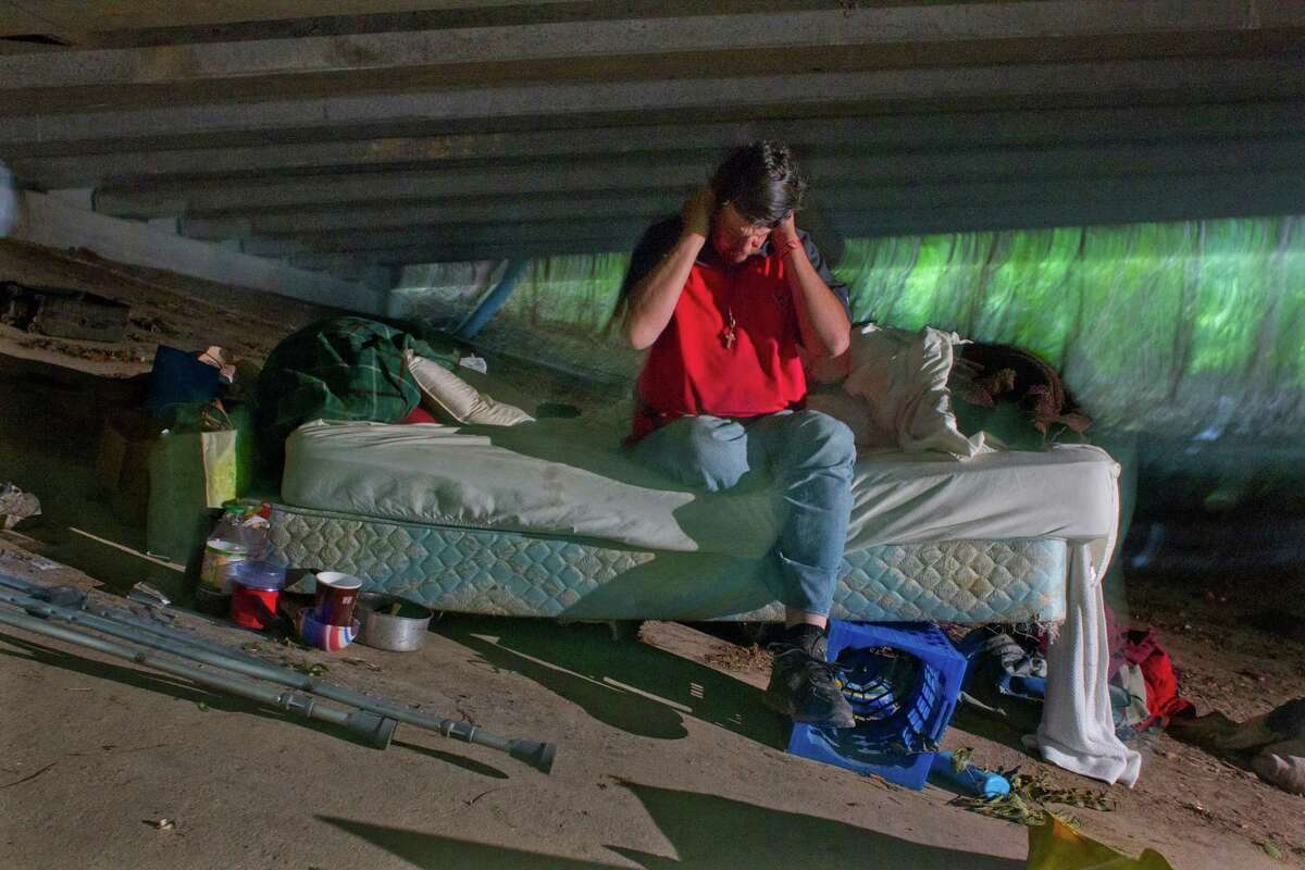 Paul Carbonneau gets his bearings as he wakes up before going out to panhandle on Woodway Drive near the West 610 Loop - his daily routine for the past 14 years.HoustonChronicle.com: A personal mission to save one man