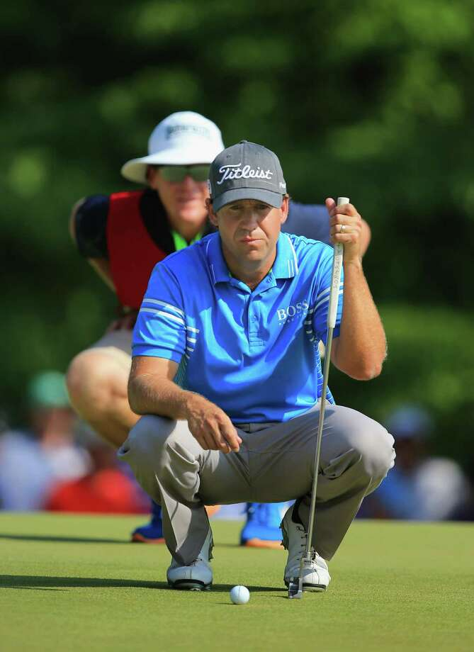 Erik Compton, who had heart transplants at the ages of 12 and 28, finds himself in the thick of U.S. Open contention after firing a 3-under 67 for one of only two rounds to break par Saturday at Pinehurst. Photo: David Cannon, Staff / 2014 Getty Images