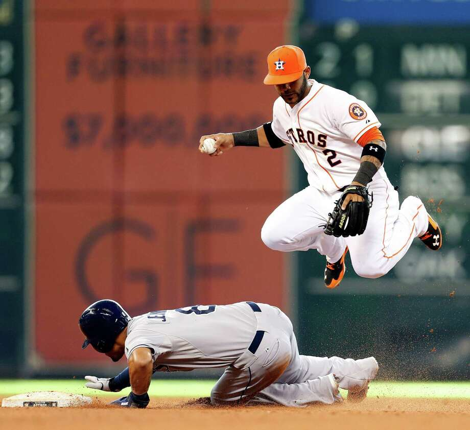 Astros shortstop Jonathan Villar leaps out of harm's way as the Rays' Desmond Jennings does his job in preventing a double play in the fifth inning. Photo: Karen Warren, Staff / © 2014 Houston Chronicle