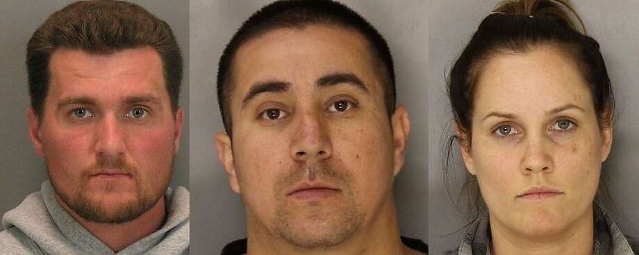 Police say, from left, Semir Metovic, Tito Hernandez, and Abby Rose were arrested with more than 800 marijuana plants, weapons, and narcotics in a massive operation in Mountain View and San Jose on Saturday, June 14, 2014. Photo: Bay City News Service