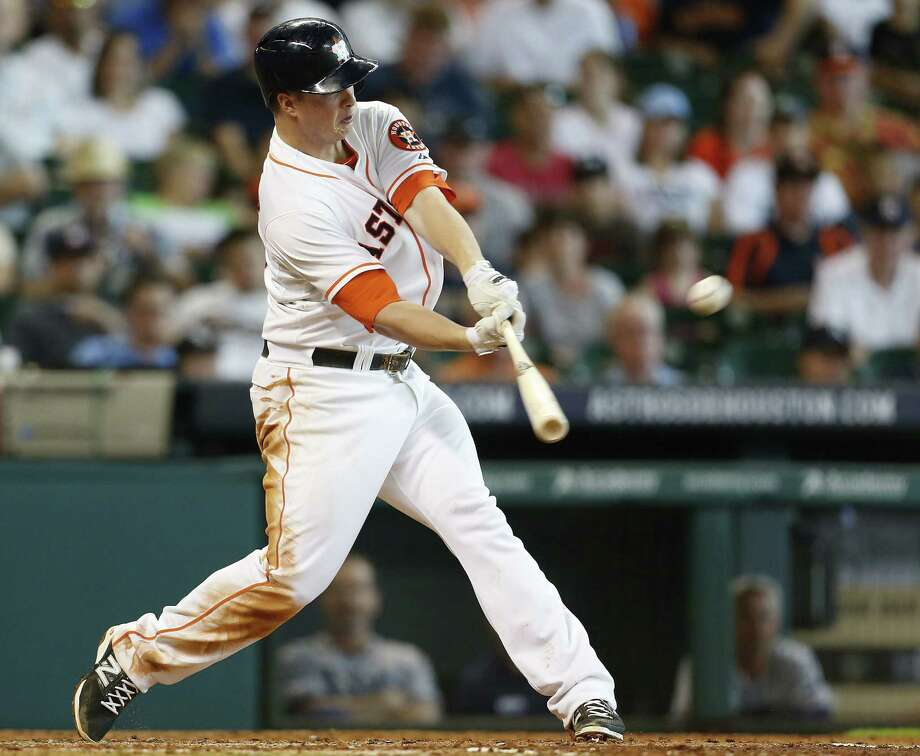 Astros third baseman Matt Dominguez broke out of a recent slump with two hits, including a three-run, third-inning double. Photo: Karen Warren / Houston Chronicle / © 2014 Houston Chronicle