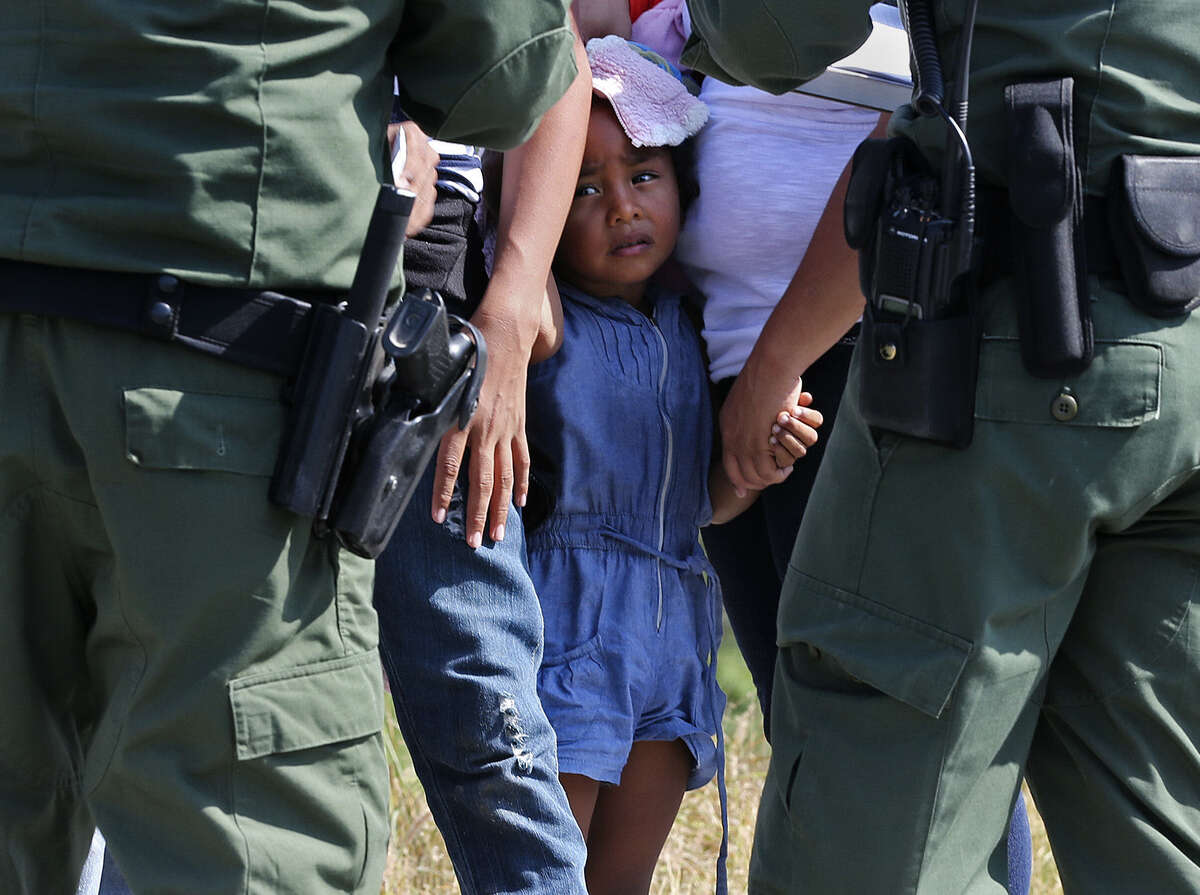 In a scene increasingly common, Border Patrol agents question adult and minor immigrants southwest of McAllen.