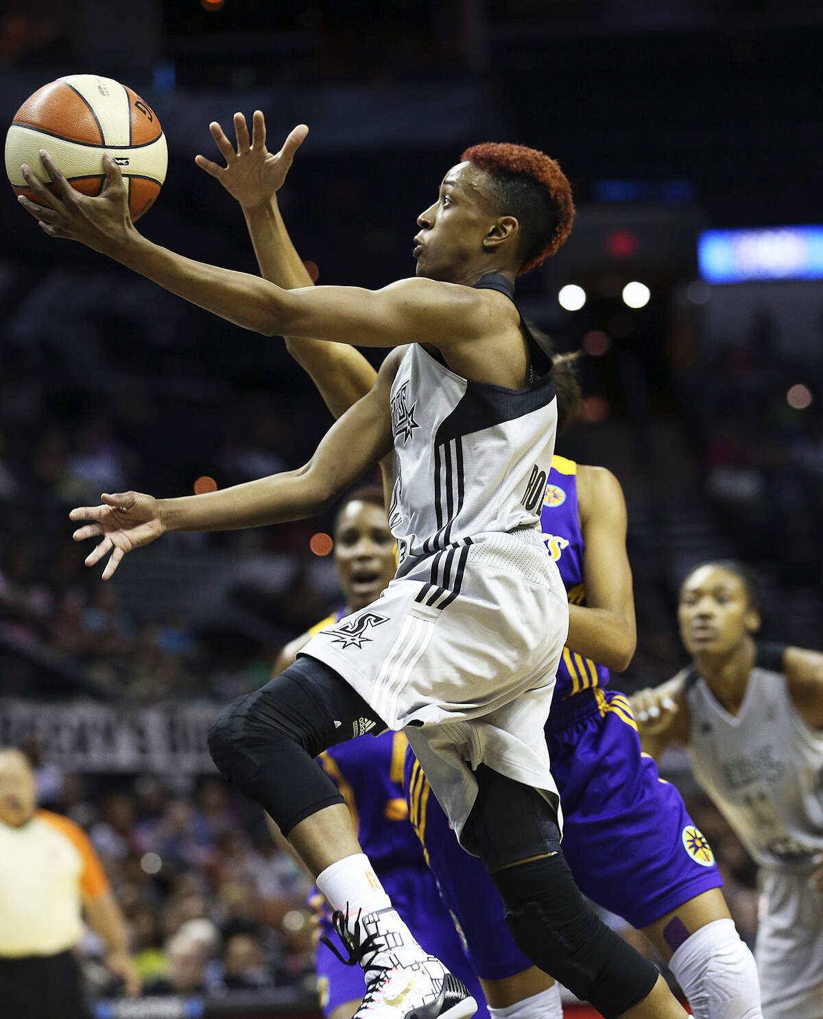 Danielle Robinson, who led all scorers with 24 points, darts to the basket for a layup attempt in the first half of the Stars' blowout victory at the AT&T Center.