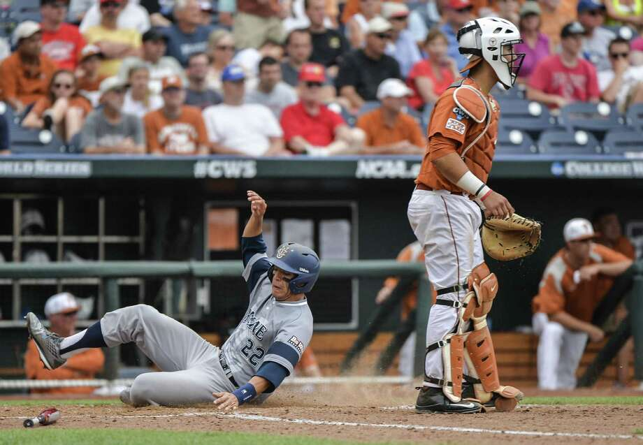 Cal-Irvine's Chris Rabago slides home safely in the Anteaters' three-run eighth inning as Texas catcher Tres Barrera looks on. Photo: Ted Kirk / Associated Press / FR34398 AP