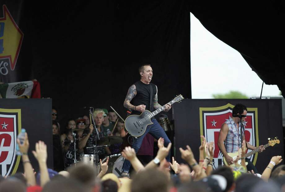 Yellowcard performs on Saturday during the Vans Warped Tour at the AT&T Center parking lot in San Antonio. Photo: Photos By Timothy Tai / San Antonio Express-News / © 2014 San Antonio Express-News