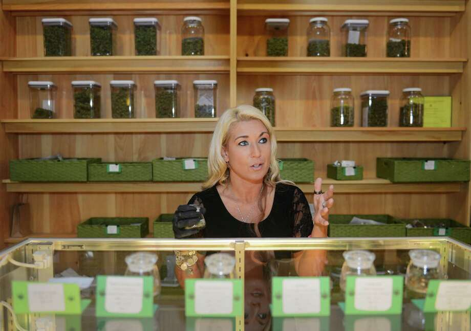 "Assistant Manager Marie Swain speaks about Greeanleaf's medical marijuana operation at the Greenleaf Compassionate Care Center in Portsmouth, R.I. Thursday, June 12, 2014.  The dispensary in Portsmouth is one of the closest medical marijuana dispensaries to the area and could give an idea of what it will be like when D&B Wellness opens its dispensary, to be named Compassionate Care Center of Connecticut, in Bethel.  Greenleaf gives patients access to many different strains, concentrates, and ""medibles,"" with a bakery and grow room located on site. Photo: Tyler Sizemore / The News-Times"