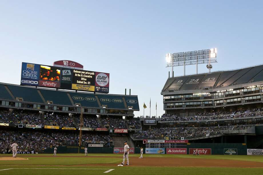 Play is suspended during the fourth inning between the Oakland Athletics and the New York Yankees because of faulty stadium lights in left field at O.co Coliseum on June 14, 2014 in Oakland, California. Photo: Jason O. Watson, Getty Images