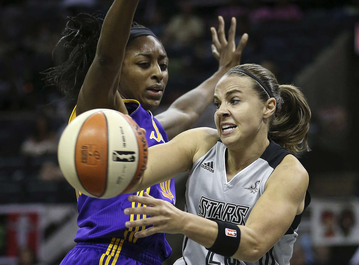 Stars point guard Becky Hammon, who had 10 points and four assists, passes around Los Angeles' Nneka Ogwumike.