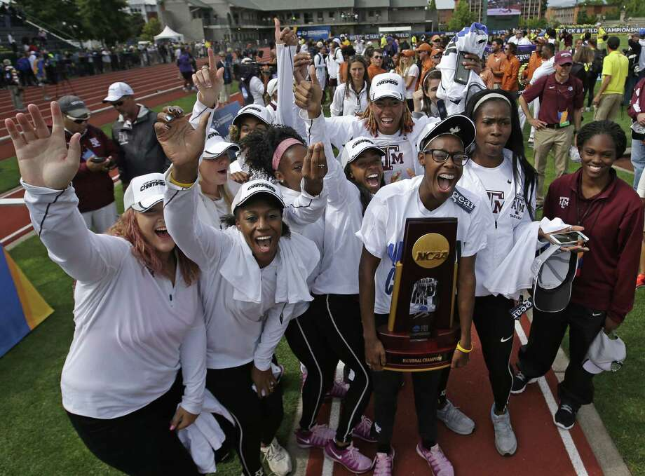 The Texas A&M women rejoice with the team trophy after winning the NCAA outdoor track and field team title in Eugene, Oregon, with 75 points. Texas was second with 66. Photo: Rick Bowmer / Associated Press / AP